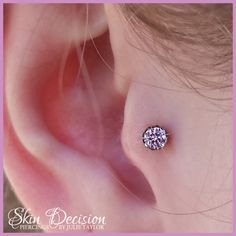 Tragus piercing with prong set pink gem by anatometal.