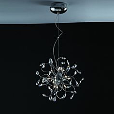 @Overstock - Extreme curves and twists of the arms on this hanging pendant form an effect unlike any other. This pendant is polished off in a gorgeous chrome silver finish, for a sleek contemporary design.http://www.overstock.com/Home-Garden/Joshua-Marshal-Home-Collection-Modern-12-light-Chrome-Crystal-Adjustable-Hanging-Pendant/6985653/product.html?CID=214117 $190.79