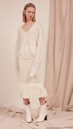 The Losara Skirt in ribbed knit off-white. With gathered elastic waistband, tassels hem, deep v back slits. COMPOSITION AND CARE Dry clean only Please treat with care to extend the life of your cloth