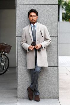 A grey overcoat and charcoal striped dress pants will showcase your sartorial self. For footwear go down the casual route with dark brown suede chukka boots. Shop this look on Lookastic: https://lookastic.com/men/looks/overcoat-blazer-dress-shirt-dress-pants-desert-boots-tie-gloves-sunglasses/2221 — Grey Wool Tie — Light Blue Dress Shirt — Dark Brown Leather Gloves — Charcoal Vertical Striped Blazer — Charcoal Vertical Striped Dress Pants — Dark Brown Suede Desert Boots — Black Sun...