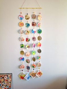 Collaged papers and beads on 12 inch dowel.