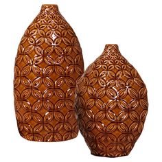 Set of 2 ceramic vases with a textured lattice motif in a mocha brown glaze.   Product: Small and large vaseConstruction...