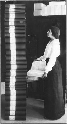 Elin Wägner standing next to 351 454 signatures demanding women get the right to vote. Sweden 1914