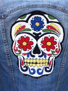 Tattoo appliqué on an old denim jacket