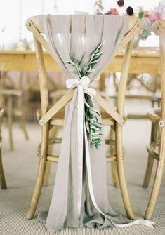 Regardless if you have simple folding chairs or beautiful banquet style ones wrapping them with pretty ribbon will totally change the look ...