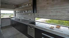 Architect Luciano Kruk and collaborators have slabbed together a rest home topographically in the highest neighborhood of Costa Esmeralda called Golf House. / Small house / Prefab homes / Mini homes / Cabins in the woods / Modern tiny house Concrete Countertops, Kitchen Countertops, Concrete Slab, Concrete Kitchen, Kitchen Worktop, Kitchen Island, Living Room Kitchen, Home Decor Kitchen, Kitchen Ideas