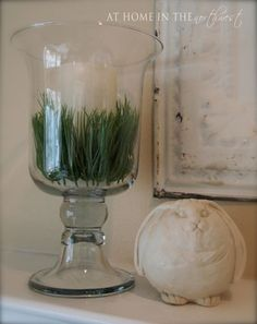 Great idea to use faux grass as a vase filler!maybe put an Easter egg on top