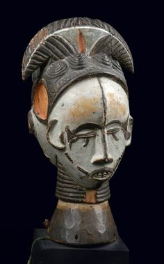 Africa | Janus headed dance crest from the Igbo people of Nigeria | Wood; matt patina, with polychrome paint