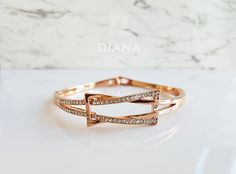 The intertwined ribbon of sparkling crystals that forms a bow adds a regal touch to this rose gold bangle. Visit our collection today for a full range of beautiful women's fashion accessories. Diana Rose, Bangles, Bracelets, Gold Rings, Fashion Accessories, Wedding Rings, Rose Gold, Engagement Rings, Crystals