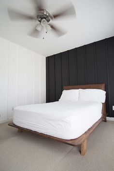 Super easy and inexpensive DIY Board and Batten Bedroom wall treatment. Super easy and inexpensive DIY Board and Batten wall treatment that will give you this classic look without costing a small fortune. White Wall Bedroom, White Bedroom Design, Accent Wall Bedroom, White Walls, Black Bedroom Walls, Diy Platform Bed Plans, Cheap Basement Remodel, Black Feature Wall, Diy Bett