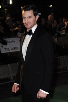 Harry chose a tuxedo by Ermenegildo Zegna. He's my Starry Night. Can tell by his hands he's a bit uptight, so I hand him a Starry Drink!  He smiles slowly.