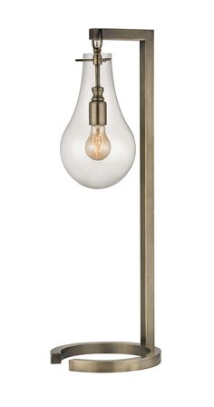 The Ensign Table Lamp delivers a gorgeous and innovative design profile that adds a modern touch to a vintage-inspired motif. Its brass-finished, angular metal stand represents a contemporary aesthetic...  Find the Ensign Table Lamp, as seen in the Industrial Iridescence Collection at http://dotandbo.com/collections/industrial-iridescence?utm_source=pinterest&utm_medium=organic&db_sku=113926