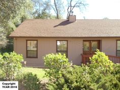 This charming home is nestled on a large corner lot (approx. 12 ac) with not one but two full size garages One can be used as a workshop. Another bonusfeature is there is plenty of room to park an RV or boat. This 1344 sf home has 3 bedrooms and 2 baths tiled kitchen counter tops and floor oak cabinetswith tons of storage and recently installed new carpet. Enjoy the peaceful setting from the deck overlooking the large backyard. This gem has functionalcharm and is located close to shopping…