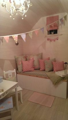 Use old crib mattress to make daubed and shelves on either side for storage