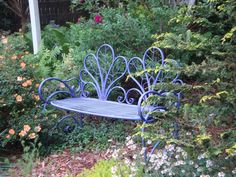 I have a passion for purple. I painted this iron bench a vibrant violet and wow the perfect touch for our garden