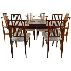 Mid-Century American Dining Set   From a unique collection of antique and modern dining room sets at https://www.1stdibs.com/furniture/tables/dining-room-sets/