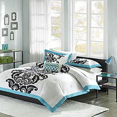 @Overstock - This three-piece bedding set offers the perfect design solution for any young girl transitioning to a more grown-up room. A bold black leaf motif on a bright white background with a teal border gives this set a pop of fun without looking too young.http://www.overstock.com/Bedding-Bath/Mizone-Santorini-Teal-Twin-Twin-XL-3-piece-Comforter-Set/6629621/product.html?CID=214117 $49.99
