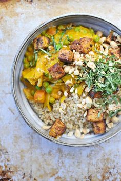 Over the next few months, you're going to want a comforting recipe you can depend on; one that's hearty, healthy, and flavorful. This vegan, gluten-free pumpkin curry — with peanuts, peas, and spiced tofu — definitely fits the bill.