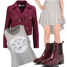 Look giovanile dedicato alle ragazze di oggi o per tutte coloro che hanno voglia di vestire trendy, l'outfit è composto da gonna in tulle in modello asimmetrico abbinata ad un top con stampa, stivali in gomma, giacca corta in finta pelle.