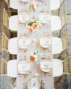 The 70 guests sat at long tables anchored with centerpieces of roses, hydrangea, cedar sprigs, and veronica and scattered votive candles. Gold chairs and rimmed plates added a bit of luster.