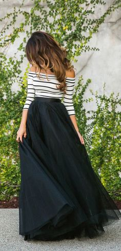 A great spring outfit for almost any occasion is an off-the-shoulder shirt tucked into a maxi skirt. It's easy, comfy, and chic.