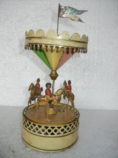 Gunthermann, wind-up carousel tin toy, c.1900, Germany