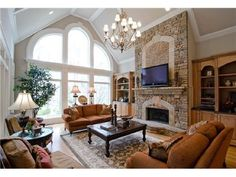 Beautiful fireplace and windows in this living room.