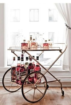 Great wheeled cart. super fun for little bar, or on a bathroom with towels on the bottom...
