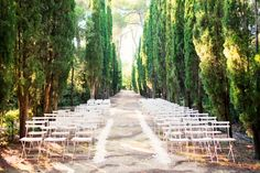 Held at the stately Chateau du Martinet in Provence, France, this wedding of an American couple (who got engaged in Provence and fell in love with the area) is as sophisticated as they come. Amidst a long aisle of cypress trees, the ceremony setting, with its white folding chairs and flower petal runners, is almost too perfect for words.