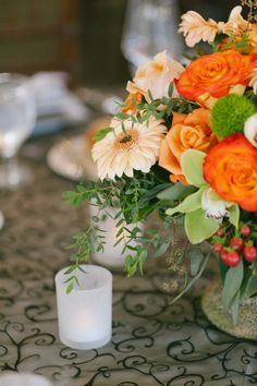 Rosemary Duff Florist | Bryan Miller Photography | green and orange flowers | table decorations| small centerpiece | wedding reception | wedding greenery | wedding day | floral design | orange rose