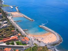 Yes? this is Madeira, a Portuguese archipelago just under 400 km north of Tenerife, Canary Islands! To be precise ? it is Calheta! A golden man-made sandy beach on the island. The sand was brought (mainly) from Morocco, but also from Figueira da Foz (Portugal).