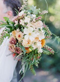 Dahlia and wildflower rustic wedding bouquet: http://www.stylemepretty.com/california-weddings/sacramento/2017/02/03/now-this-is-how-you-do-a-barn-wedding/ Photography: Meghan Mehan - https://meghanmehan.com/