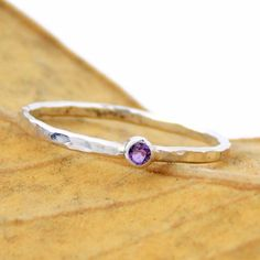 These Tiny Hammered Birthstone Rings can be set with your choice of birthstone…