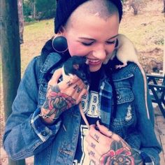 Hand tattoos stretched ears vest punk