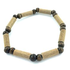 Hazelwood All Brown Bracelet (Economy Price)! Effective in reducing acid-based ailments and symptoms, such as eczema, acid-reflux, and heartburn, and ulcers. Must be placed directly on the skin and worn 24/7. Made with nylon-coated steel wire, hazelwood and assorted beads on elastic (no clasp).
