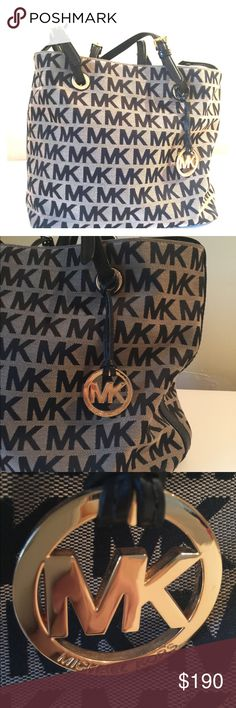 Michael Kors Black and Tan tote handbag Fabulous condition. Close up shot of MK shows bottom as you can see looks BRAND NEW. This bad was admired, not used! Had two babies when I got it so only use diaper bags! This is a roomy bad with zipper pouch on inside and snaps close. Good details shiny no dings. It sparkles. Bags Totes