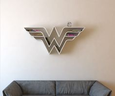 These Superhero Emblem Bookshelves Are Perfect For Any Geek Den! [Pics]
