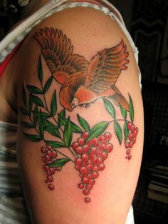 Bird and red berry tattoo
