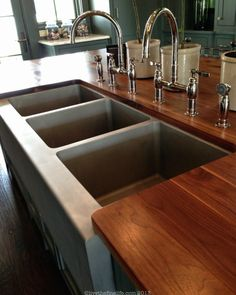 Bead blasted, commercial SS sink in a residential kitchen:: Southern Living Idea House #slideahouse via livethefinelife.com