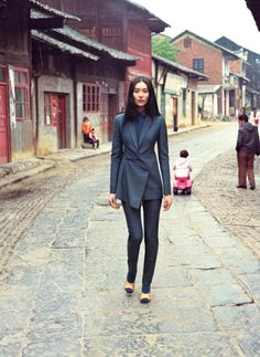Liu Wen wanders down a street of traditional houses near the Liuzi temple in Yongzhou, China.