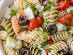 This delicious Greek Pasta Salad is filled with rotini pasta, tomatoes, cucumber, olives, and feta cheese and is covered in a tasty greek dressing! It's our new go-to pasta salad and is perfect especially in spring and summer. Tomato Pasta Salad, Pasta Salad For Kids, Easy Pasta Salad Recipe, Feta Pasta, Greek Salad Pasta, Healthy Salad Recipes, Pasta Recipes, Zoes Kitchen Pasta Salad Recipe, Noodle Salad
