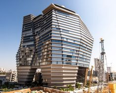 "Ron Arad has completed an office tower in Tel Aviv ""inspired by an iceberg"" with an angular glass exterior that widens in the middle. Pitsou Kedem, Elevator Lobby, Architectural Association, Ron Arad, Elevation Plan, Tower Building, Holocaust Memorial, Local Architects, Ground Floor Plan"