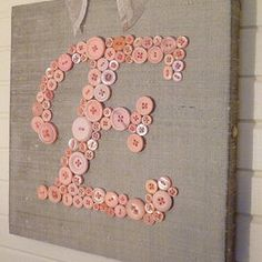 glue or stitch on letters, maybe put scrapbook paper on the canvas to spice it up