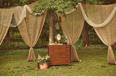 Burlap Curtains...Hmmm, I wonder what these would look like in a home. Too much?