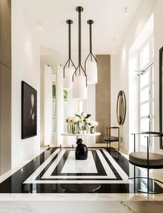 A black and white marble floor sets a dramatic tone in the foyer of Kelly Hoppen's London home. In these spaces, the most show-stopping design elements are beneath your feet. Home Design, Design Entrée, Flur Design, Deco Design, Design Ideas, Paris Design, Lobby Design, Design Trends, Design Projects