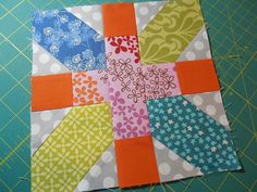 The X and + block from A Quilters Table.   I like the scrappiness. http://aquilterstable.blogspot.com/2013/07/crossex.html
