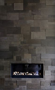 Suzie: Michael Abrams Limited - Sleek gray modern fireplace with slate tiles.---we could do this for the backsplash.it& be a lot of cutting, but totally worth it. Stone Tile Fireplace, Linear Fireplace, Fireplace Wall, Fireplace Surrounds, Fireplace Design, Fireplace Ideas, Fireplace Modern, Fireplace Backsplash, Stone Fireplaces