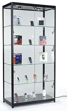 If you buy this lighted display case for your shop-owning friend... you just win. You really do. With sleek wrap-around glass and 20 watt halogen ceiling and sidelights, anything showcased inside turns to gold. Powerful presentation does the job 99% of the time. A more expensive gift than typical, but if your friend is really special, they obviously deserve this. Trophy Cabinets, Glass Curio Cabinets, Glass Shelves Kitchen, Display Cabinets, China Cabinet, Kitchen Cabinets, Wall Shelves, Shelving, Floating Glass Shelves