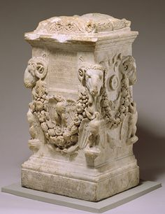 Funerary altar, 14–68; Julio-Claudian  Roman  Marble.  The heavy garland suspended from rams' heads derives from the kind of decoration found on the walls of public sanctuaries and altars. All three types of bird that surround the garland are familiar from Augustan monuments. (http://pinterest.com/pin/461759768013389058/)