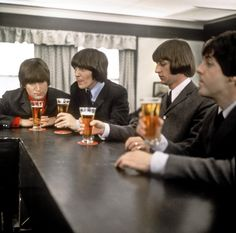The Beatles drink a beer in a still from their movie 'Help!' which was released in 1965. (L-R) John Lennon, George Harrison, Ringo Starr and Paul McCartney. (Photo by Michael Ochs Archives/Getty Images)
